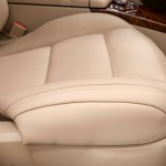 Front leather seat of car. Business auto interior detail.